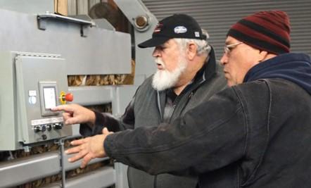 2 men using a machine